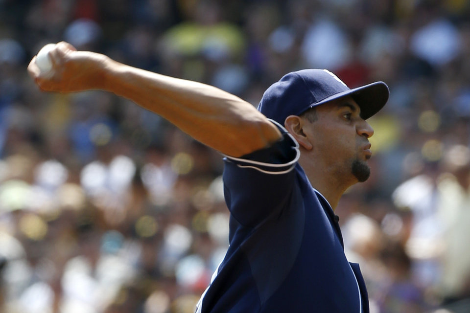 San Diego Padres starting pitcher Tyson Ross throws against the Pittsburgh Pirates in the first inning of a baseball game on Sunday, Aug. 10, 2014, in Pittsburgh. (AP Photo/Keith Srakocic)