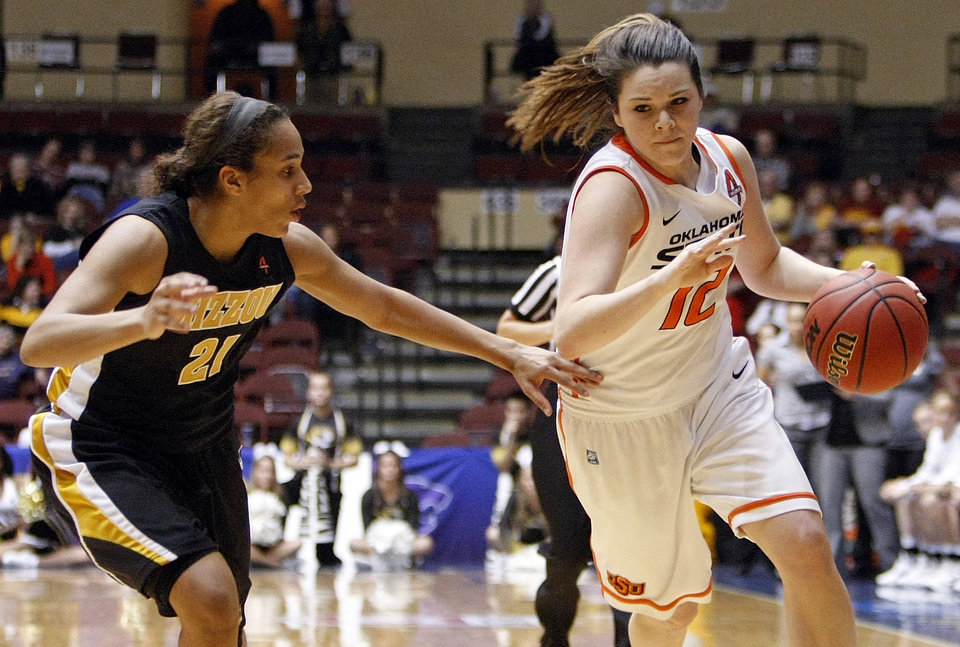 OSU\'s Jordan Schultz (12) dribbles past Missouri\'s Sydney Crafton (21) during the Big 12 tournament women\'s college basketball game between the Oklahoma State University Cowgirls and the University of Missouri Tigers at Municipal Auditorium in Kansas City, Mo., Wednesday, March 7, 2012. Mizzou won, 72-68. Photo by Nate Billings, The Oklahoman