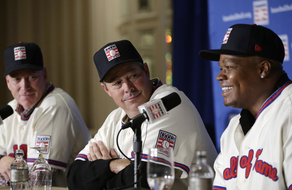 Photo - From left, former Atlanta Braves pitchers Tom Glavine, left, and Greg Maddux, center, listen as former Chicago White Sox slugger Frank Thomas speaks during a press conference announcing their election into the 2014 Baseball Hall of Fame class, Thursday, Jan. 9, 2014, in New York.  The trio will be inducted into the Hall of Fame in Cooperstown, N.Y. in July 2014. (AP Photo/Kathy Willens)