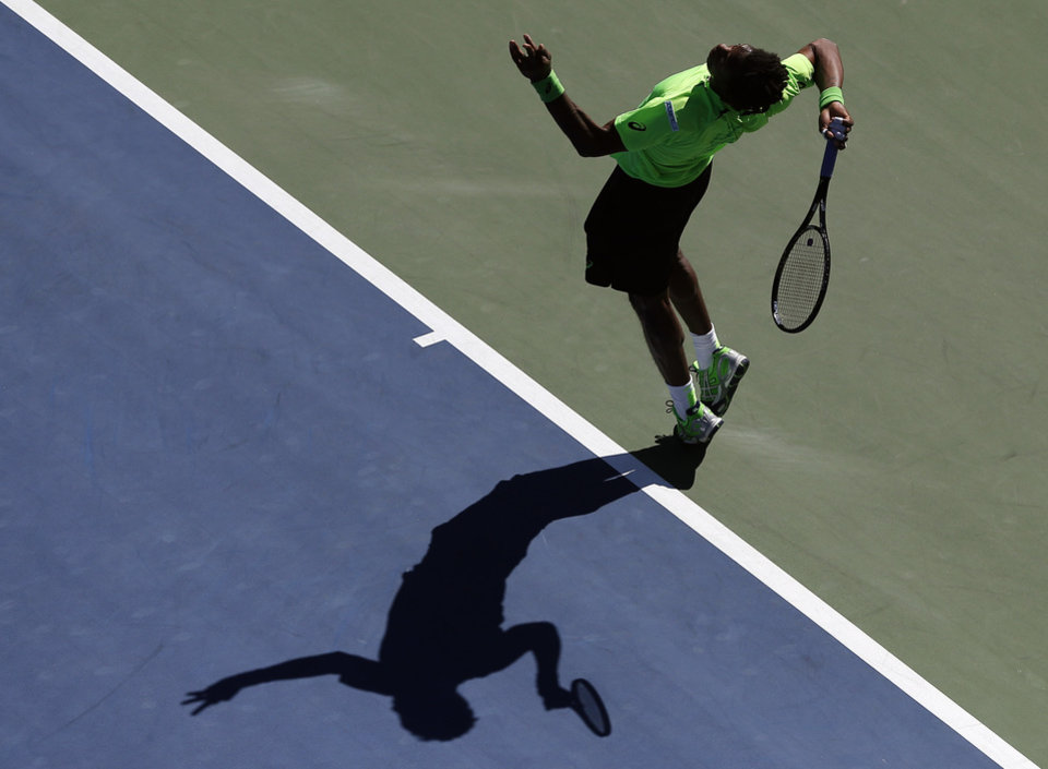 Photo - Gael Monfils, of France, serves against Alejandro Gonzalez, of Colombia, during the second round of the 2014 U.S. Open tennis tournament, Friday, Aug. 29, 2014, in New York. (AP Photo/Elise Amendola)