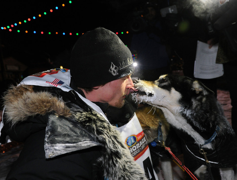 Photo - Dallas Seavey gets a kiss from one of his dogs after winning the 2014 Iditarod Trail Sled Dog Race in Nome, Alaska, Tuesday, March 11, 2014.  (AP Photo/The Anchorage Daily News, Bob Hallinen)  LOCAL TV OUT (KTUU-TV, KTVA-TV) LOCAL PRINT OUT (THE ANCHORAGE PRESS, THE ALASKA DISPATCH)