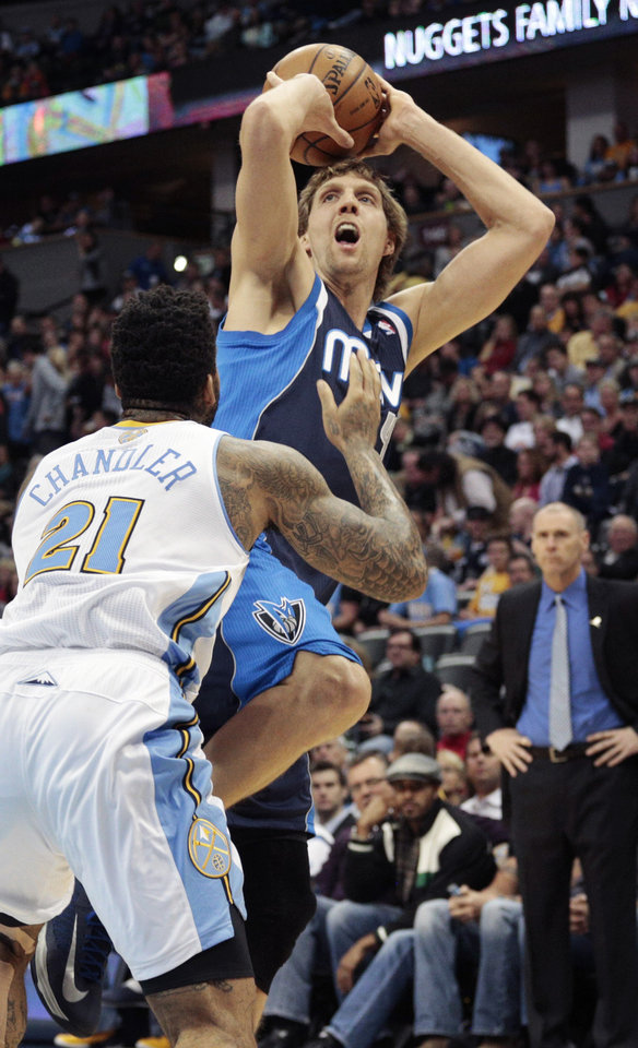 Photo - Dallas Mavericks forward Dirk Nowitzki (41) shoots against Denver Nuggets forward Wilson Chandler (21) during the first quarter of an NBA basketball game in Denver on Saturday, Nov. 23, 2013. (AP Photo/Joe Mahoney)