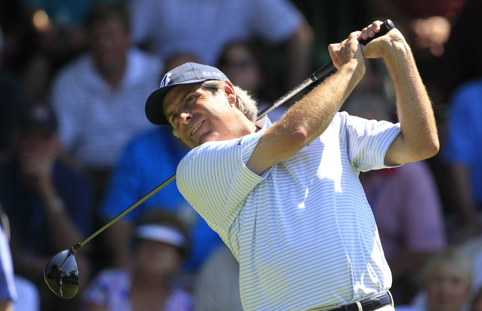 Photo -   Fred Couples drives on the first hole during the first round at the U.S. Senior Open golf tournament at the Indianwood Golf and Country Club in Lake Orion, Mich., Thursday, July 12, 2012. (AP Photo/Carlos Osorio)