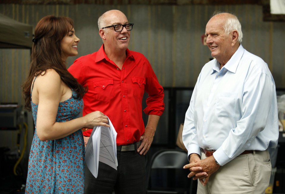 Photo - MOVIE: Lance McDaniel, center, talks with actress Patricia De Leon and Gray Frederickson on the set of film