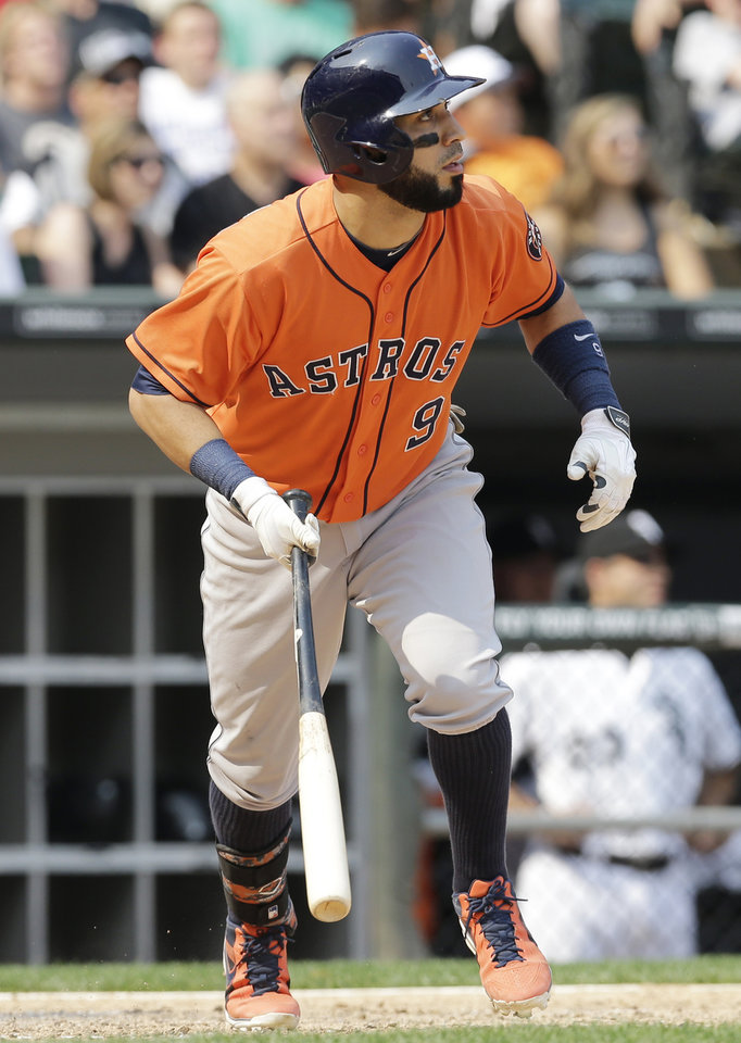Photo - Houston Astros' Marwin Gonzalez watches after hitting a two-run single against the Chicago White Sox during the seventh inning of a baseball game in Chicago on Sunday, July 20, 2014. (AP Photo/Nam Y. Huh)