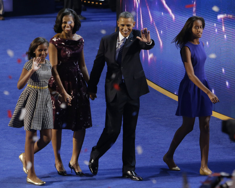 Photo -   President Barack Obama and his family, Michele, Sasha, left and Malia, right exit the stage at the Democratic National Convention in Charlotte, N.C., on Thursday, Sept. 6, 2012. (AP Photo/Lynne Sladky)