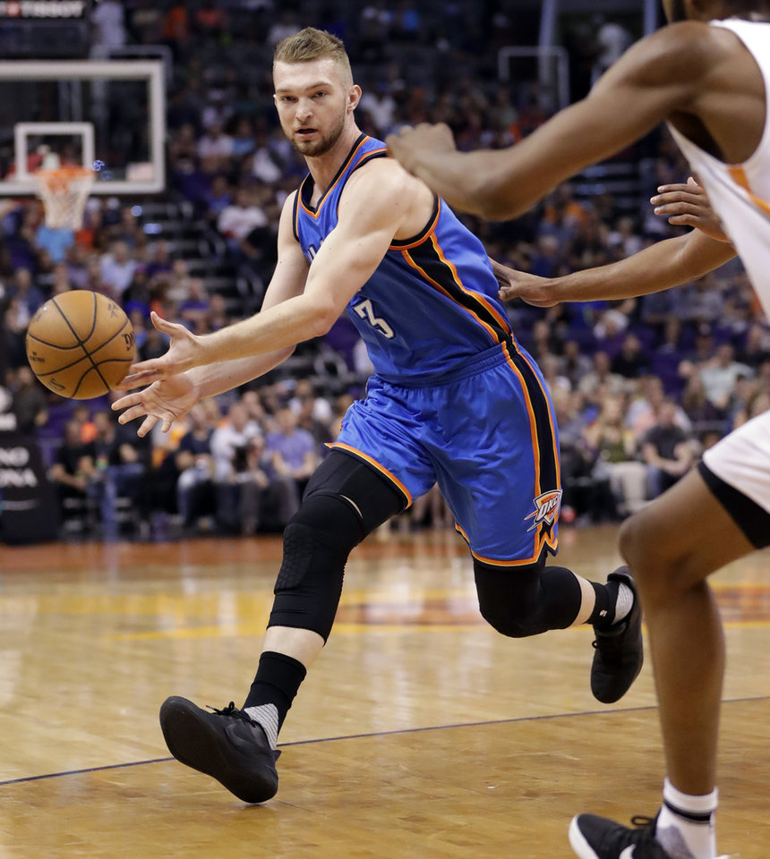 Photo - Oklahoma City Thunder forward Domantas Sabonis (3) passes against the Phoenix Suns during the first half of an NBA basketball game, Friday, April 7, 2017, in Phoenix. (AP Photo/Matt York)