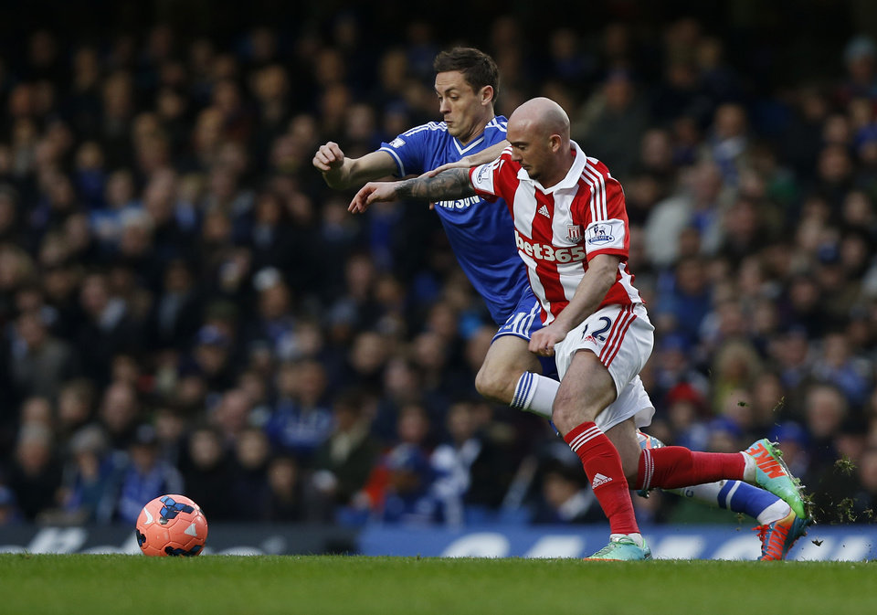 Photo - Chelsea's Nemanja Matic, left, competes with Stoke City's Stephen Ireland during their English FA Cup fourth round soccer match at Stamford Bridge, London, Sunday, Jan. 26, 2014. (AP Photo/Sang Tan)