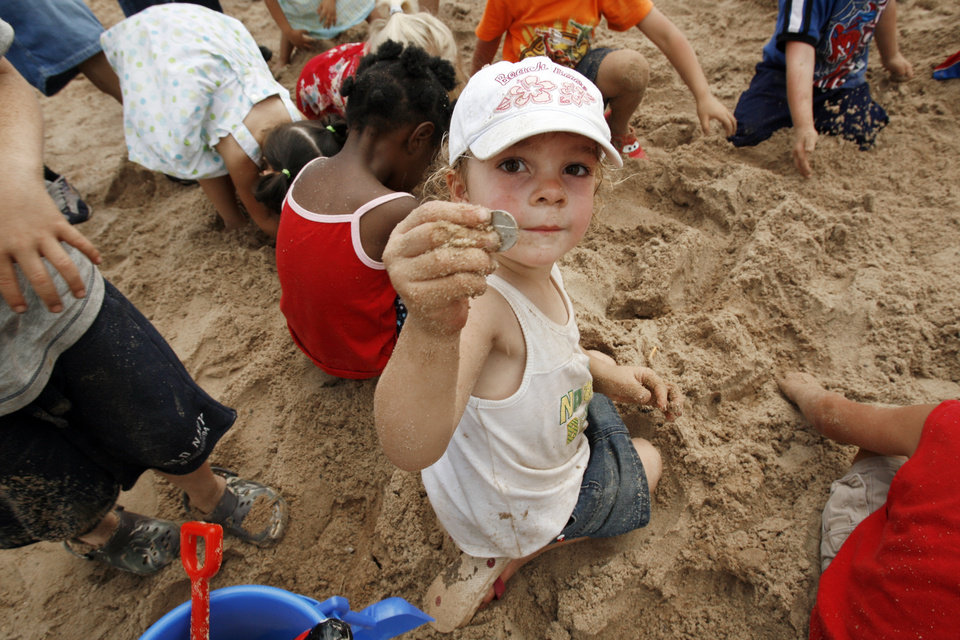 Devin Jansing, 4, from Norman, discovers a coin in the nickel find sand pit during Norman Independence Day Celebration at Reaves Park in Norman, Okla., on Saturday, July 4, 2009.     Photo by Steve Sisney, The Oklahoman