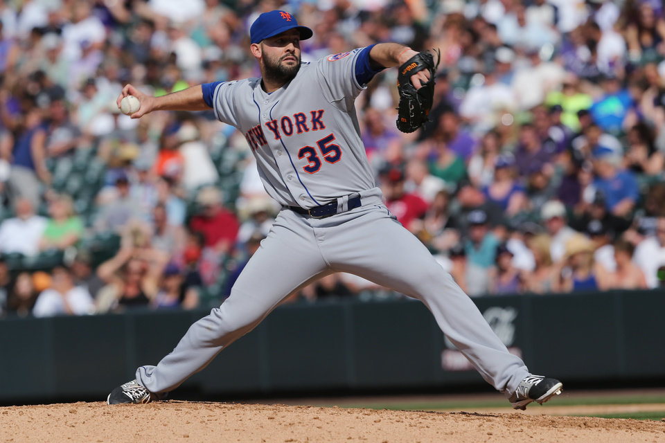 Photo - New York Mets starting pitcher Dillon Gee works against the Colorado Rockies in the seventh inning of the Mets' 5-1 victory in a baseball game in Denver, Sunday, May 4, 2014. (AP Photo/David Zalubowski)