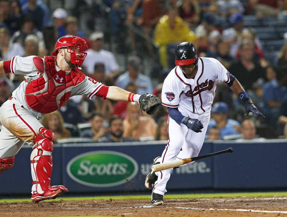 Photo - Philadelphia Phillies catcher Cameron Rupp reaches to tag out Atlanta Braves' Christian Bethancourt (25) after dropping the third strike in the fourth inning of a baseball game in Atlanta, Friday, July 18, 2014. Bethancourt was out at first base. (AP Photo/John Bazemore)
