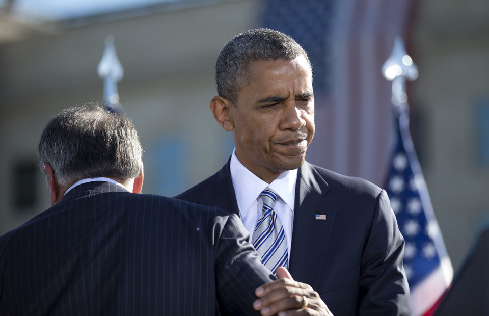 President Barack Obama walks past Defense Secretary Leon Panetta as he moves to the podium to speak at the Pentagon Memorial, Tuesday, Sept. 11, 2012, during a ceremony to mark the 11th anniversary of the Sept. 11 attacks. (AP Photo/Carolyn Kaster)