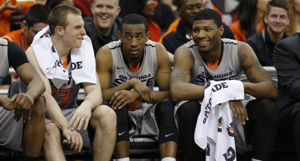 Oklahoma State's Phil Forte, left, Markel Brown and Marcus Smart, right, are going to the NCAA Tournament to face Gonzaga.                   Photo by Bryan Terry, The Oklahoman