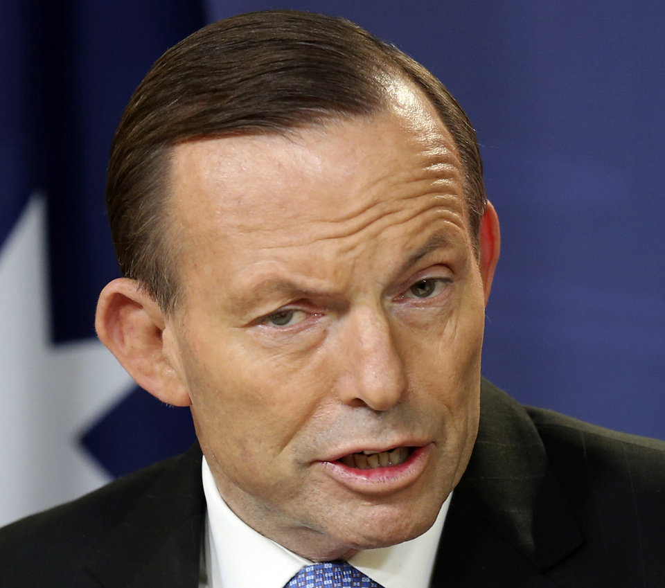 Photo - FILE - In this July 19, 2014 file photo, Australia's Prime Minister Tony Abbott speaks during a press conference in Sydney, Australia. Abbott said Wednesday, July 30, 2014 that he is not considering ratcheting up sanctions against Russia while his government focuses on retrieving Australian victims from the wreckage of the Malaysian airliner disaster in Ukraine. (AP Photo/Rob Griffit, File)