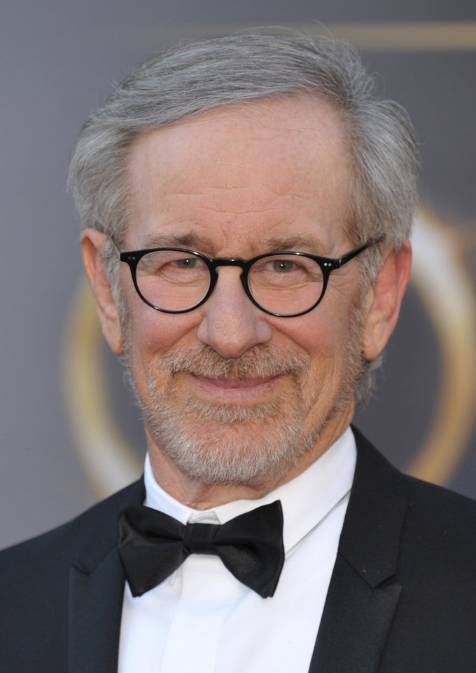 "FILE - In this Feb. 24, 2013 file photo, director Steven Spielberg arrives at the Oscars at the Dolby Theatre in Los Angeles. Spielberg has his sights set on his next film. A spokeswoman for DreamWorks Studios said Thursday, May 2, 2013,  the filmmaker plans to direct Bradley Cooper in an adaptation of the best-selling book ""American Sniper."" (Photo by John Shearer/Invision/AP, File)"