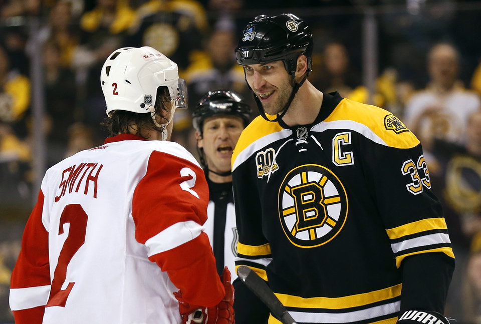 Photo - Boston Bruins' Zdeno Chara (33) stares at Detroit Red Wings' Brendan Smith during the first period of Game 2 of a first-round NHL hockey playoff series in Boston Sunday, April 20, 2014. (AP Photo/Winslow Townson)