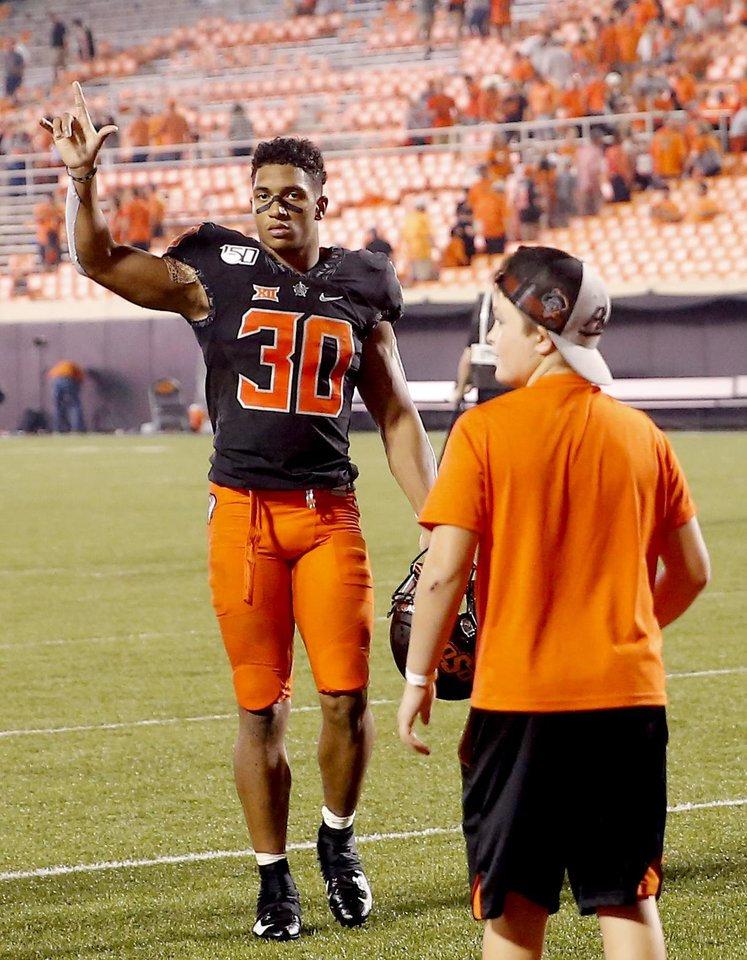 Photo - Oklahoma State's Chuba Hubbard (30) acknowledges the fans following the college football game between the Oklahoma State Cowboys and the Kansas State Wildcats at Boone Pickens Stadium in Stillwater, Okla., Saturday, Sept. 28, 2019.  OSU won 26-13. [Sarah Phipps/The Oklahoman]