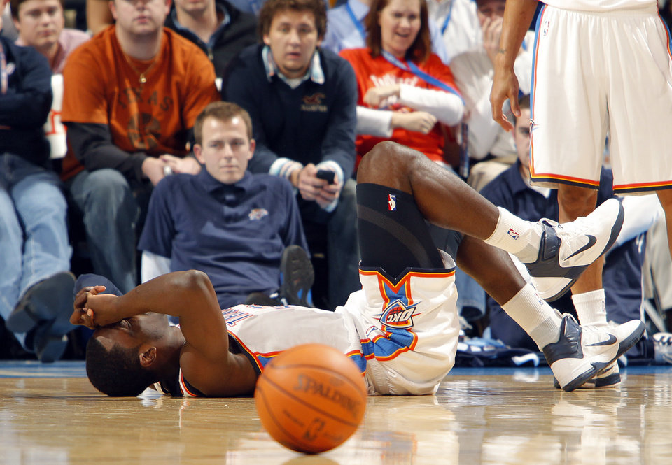 Photo - The Thunder's Jeff Green lies on the court after a turnover during the NBA basketball game between the Oklahoma City Thunder and the Memphis Grizzlies at the Oklahoma City Arena on Tuesday, Feb. 8, 2011, Oklahoma City, Okla.Photo by Chris Landsberger, The Oklahoman