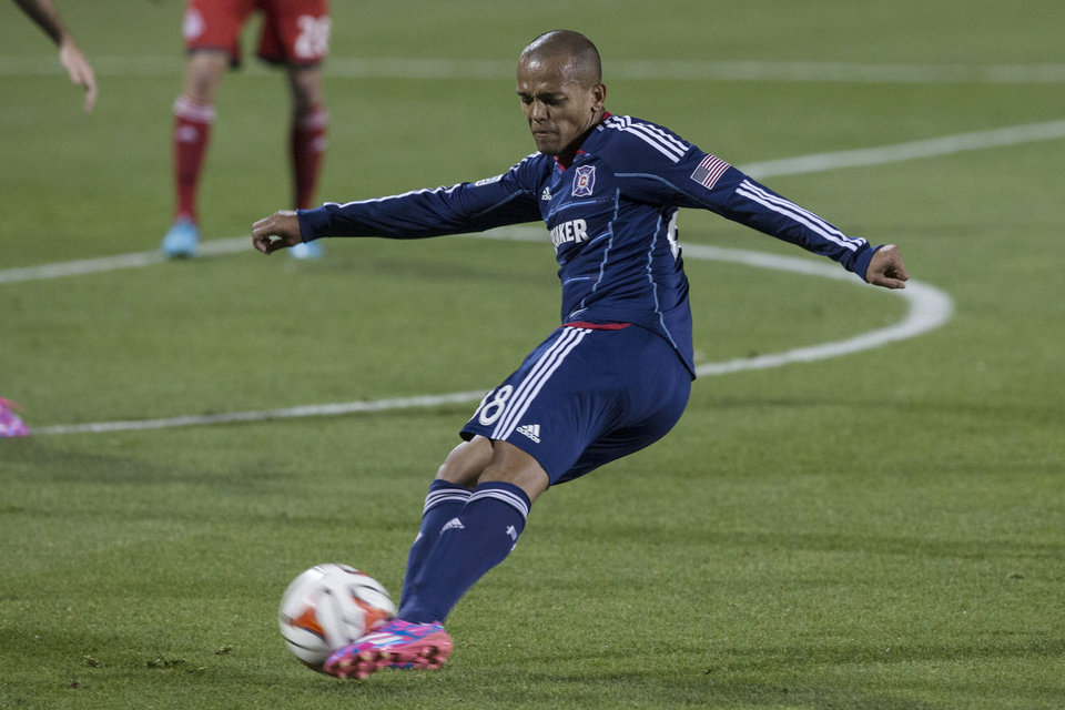Photo - Chicago Fire's new signing Robert Earnshaw gets a shot away at goal during the second half of a soccer game, Saturday, Aug. 23, 2014 in Toronto. (AP Photo/The Canadian Press, Chris Young)