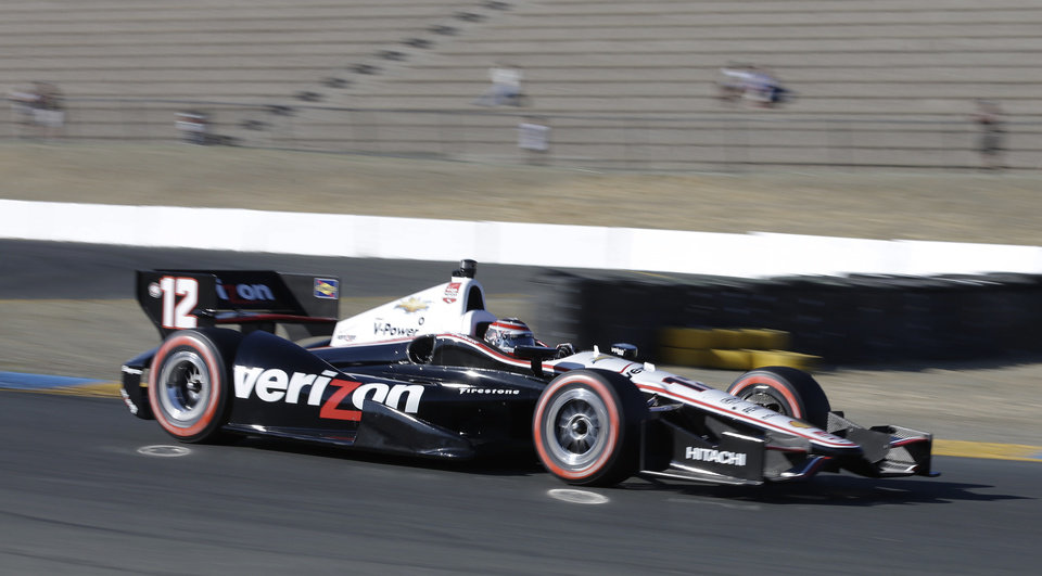 Photo - Will Power, of Australia, drives during qualifying for the IndyCar series auto race Saturday, Aug. 23, 2014, in Sonoma, Calif. Power won the pole position. (AP Photo/Eric Risberg)