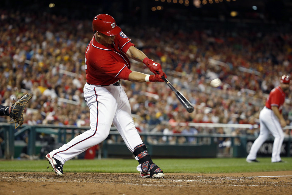 Photo - Washington Nationals' Wilson Ramos hits the game-winning ground rule double to score Bryce Harper during the ninth inning of a baseball game against the Pittsburgh Pirates at Nationals Park, Saturday, Aug. 16, 2014, in Washington. The Nationals won 4-3. (AP Photo/Alex Brandon)