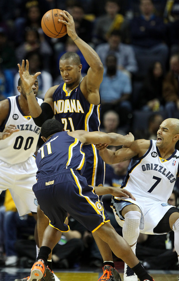 Photo - Indiana Pacers forward David West (21) and guard Orlando Johnson (11) get trapped by Memphis Grizzlies guard Jerryd Bayless (7) and forward Darrell Arthur (00) in the first half of an NBA basketball game on Monday, Jan. 21, 2013, in Memphis, Tenn. (AP Photo/Lance Murphey)
