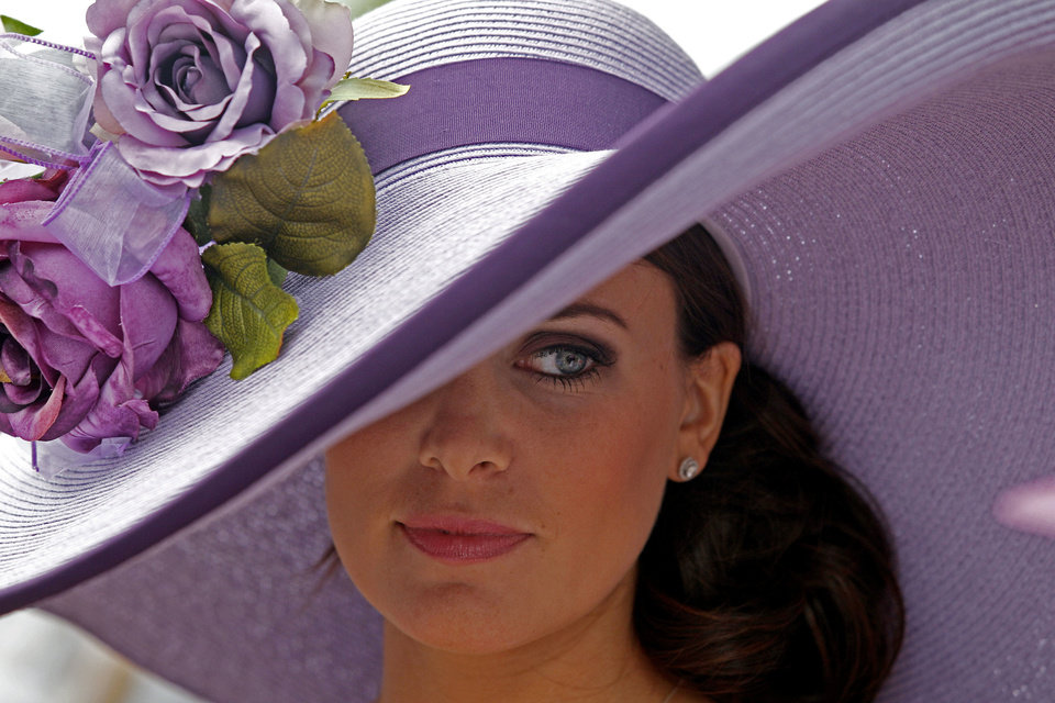 Photo - Tamara Sorreoo, from Austin, Tx., shows off her Derby hat before the 137th Kentucky Derby horse race at Churchill Downs Saturday, May 7, 2011, in Louisville, Ky. (AP Photo/Denis Paquin)  Denis Paquin - AP