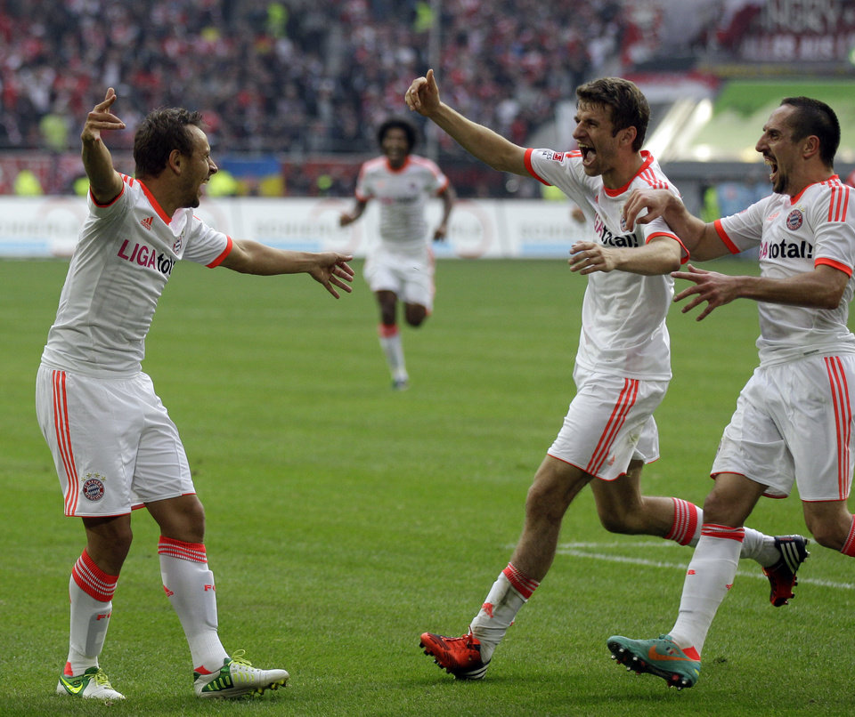 Photo -   Bayern's Rafinha of Brazil, left, celebrates with teammates Thomas Mueller and Franck Ribery of France, right, after scoring during the German first division Bundesliga soccer match between Fortuna Duesseldorf and Bayern Munich in Duesseldorf, Germany, Saturday, Oct. 20, 2012. Bayern won the match with 5-0. (AP Photo/Frank Augstein)