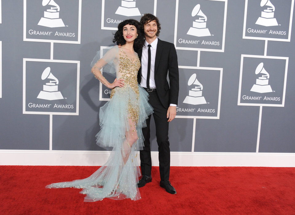 Photo - Kimbra, left, and Gotye arrive at the 55th annual Grammy Awards on Sunday, Feb. 10, 2013, in Los Angeles.  (Photo by Jordan Strauss/Invision/AP)