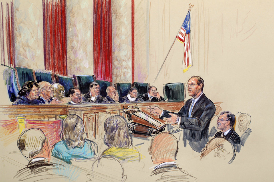 "This artist rendering shows Paul Clement, arguing for Arizona, before the Supreme Court in Washington, Wednesday, April 25, 2012, during the court's hearing on Arizona's ""show me your papers"" immigration law. Justices, from left are, Sonia Sotomayor, Stephen Breyer, Clarence Thomas, Antonin Scalia, Chief Justice John Roberts, Anthony Kennedy, Ruth Bader Ginsburg, and Samuel Alito. (AP Photo/Dana Verkouteren) ORG XMIT: DCCD122"