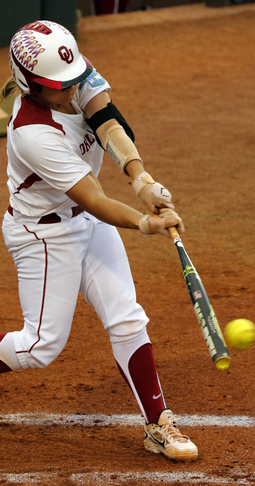 Photo - Oklahoma's Georgia Casey drives in a run on this hit as the University of Oklahoma Sooner (OU) softball team plays Tennessee in the first game of the NCAA super regional at Marita Hynes Field on May 23, 2014 in Norman, Okla. Photo by Steve Sisney, The Oklahoman