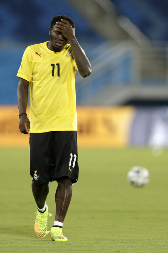 Photo - Ghana's Sulley Muntari walks on the pitch during an official training session the day before the group G World Cup soccer match between Ghana and the United States at the Arena das Dunas in Natal, Brazil, Sunday, June 15, 2014. (AP Photo/Dolores Ochoa)