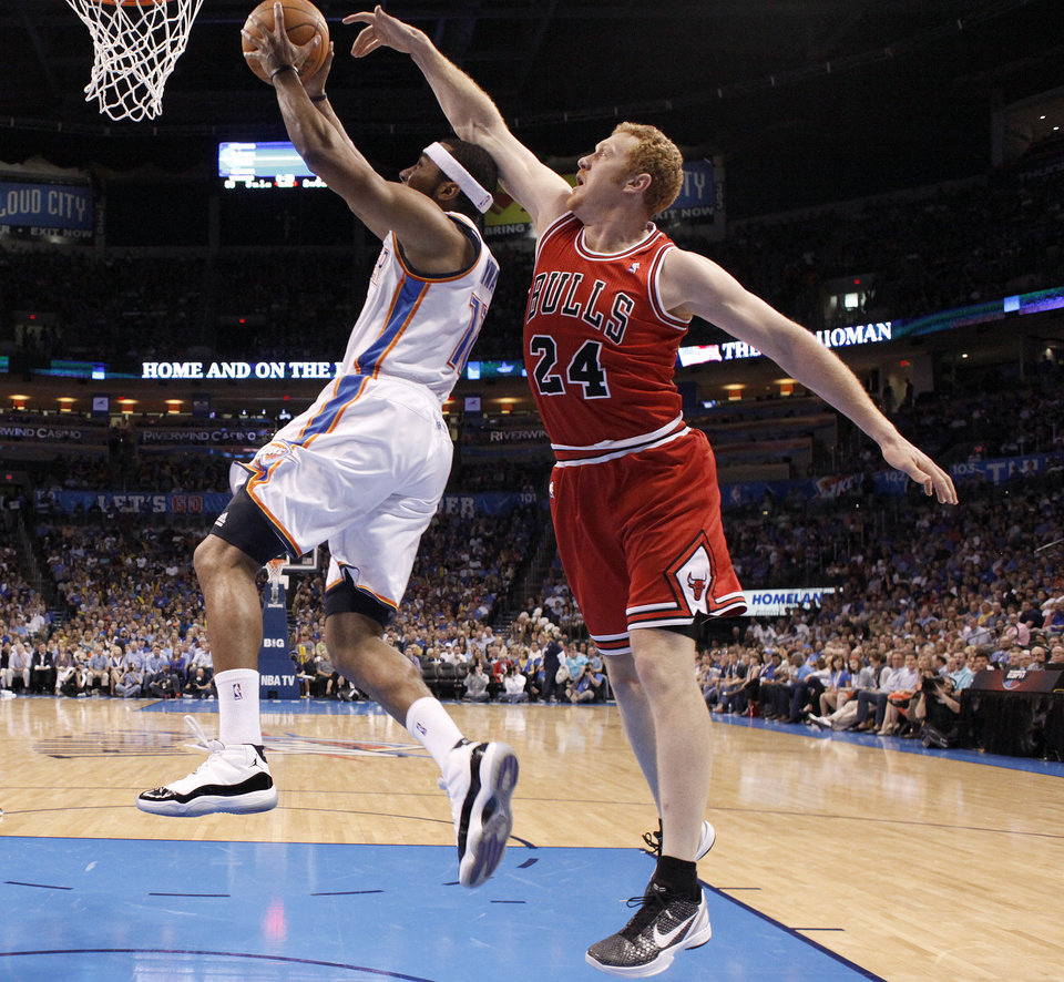 Photo - Oklahoma City's Lazar Hayward (11) shoots a lay up as Chicago's Brian Scalabrine (24) during the NBA basketball game between the Chicago Bulls and the Oklahoma City Thunder at Chesapeake Energy Arena in Oklahoma City, Sunday, April 1, 2012. Photo by Sarah Phipps, The Oklahoman