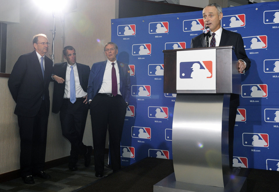 Photo - From left, St. Louis Cardinals chairman Bill DeWitt Jr., chairman of a baseball commissioner succession committee, Major League Baseball spokesman Pat Courtney, Major League Baseball Commissioner Allan H.