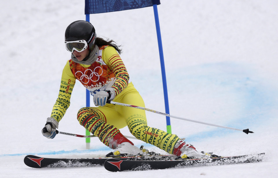 Photo - Togo's Alessia Afi Dipol passes a gate in the first run of the women's giant slalom at the Sochi 2014 Winter Olympics, Tuesday, Feb. 18, 2014, in Krasnaya Polyana, Russia. (AP Photo/Charles Krupa)