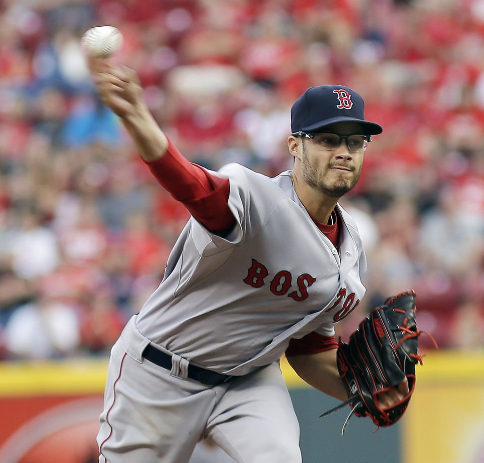 Photo - Boston Red Sox pitcher Joe Kelly throws in the first inning of a baseball game against the Cincinnati Reds, Tuesday, Aug. 12, 2014, in Cincinnati. (AP Photo/Tony Tribble)