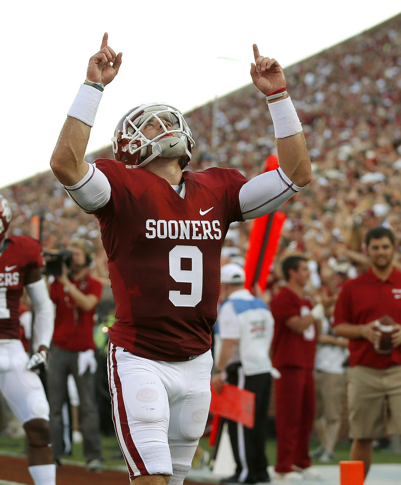 Photo - Oklahoma's Trevor Knight (9) reacts after a touchdown during a college football game between the University of Oklahoma Sooners (OU) and the University of Louisiana Monroe Warhawks at Gaylord Family-Oklahoma Memorial Stadium in Norman, Okla., on Saturday, Aug. 31, 2013. Oklahoma won 34-0. Photo by Bryan Terry The Oklahoman