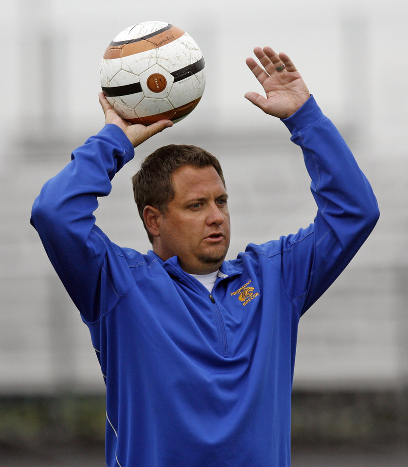 Photo - Coach Zac Selph leads boys soccer practice at Piedmont High School in Piedmont, Okla., Wednesday, April 11, 2012. Photo by Nate Billings, The Oklahoman