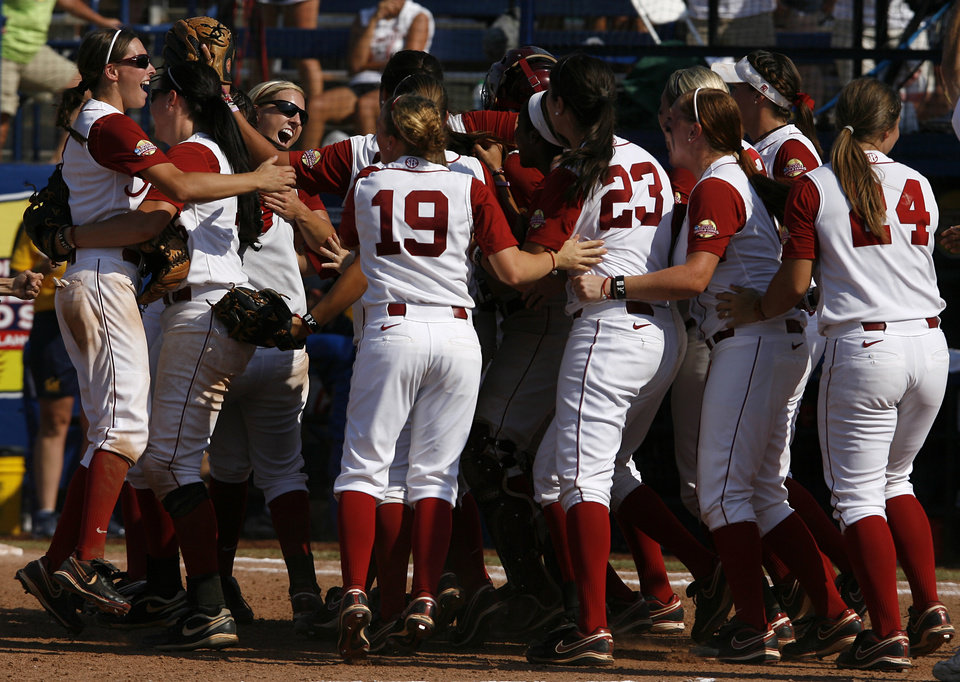Photo - Alabama celebrates a win against California during a Women's College World Series game at ASA Hall of Fame Stadium in Oklahoma City, Sunday, June 3, 2012.  Photo by Garett Fisbeck, The Oklahoman