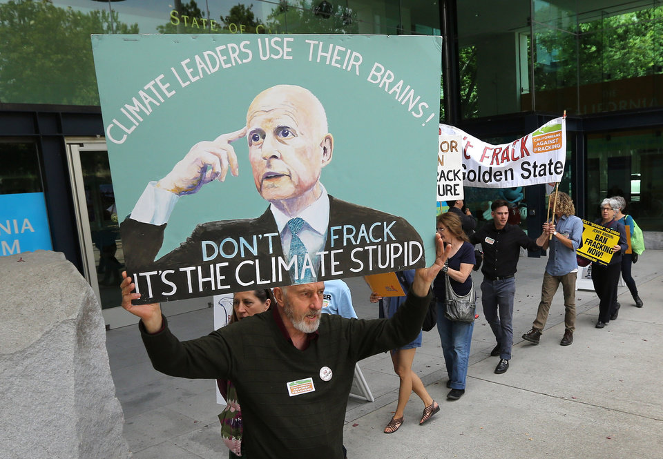 Photo - Richard Gray joined others in a demonstration calling on Gov. Jerry Brown to end hydraulic fracturing for oil and gas, before  Brown's appearance before the University of California  Giannini Foundation of Agricultural Economics conference in  Sacramento, Calif., Monday, May 19, 2014.(AP Photo/Rich Pedroncelli)