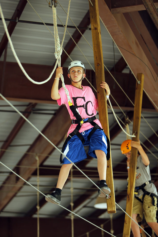 Camper participate in a ropes course under the roof of an outdoor park at Falls Creek Youth Camp on Tuesday, June 25, 2013 in Davis, Okla.  Photo by Steve Sisney, The Oklahoman