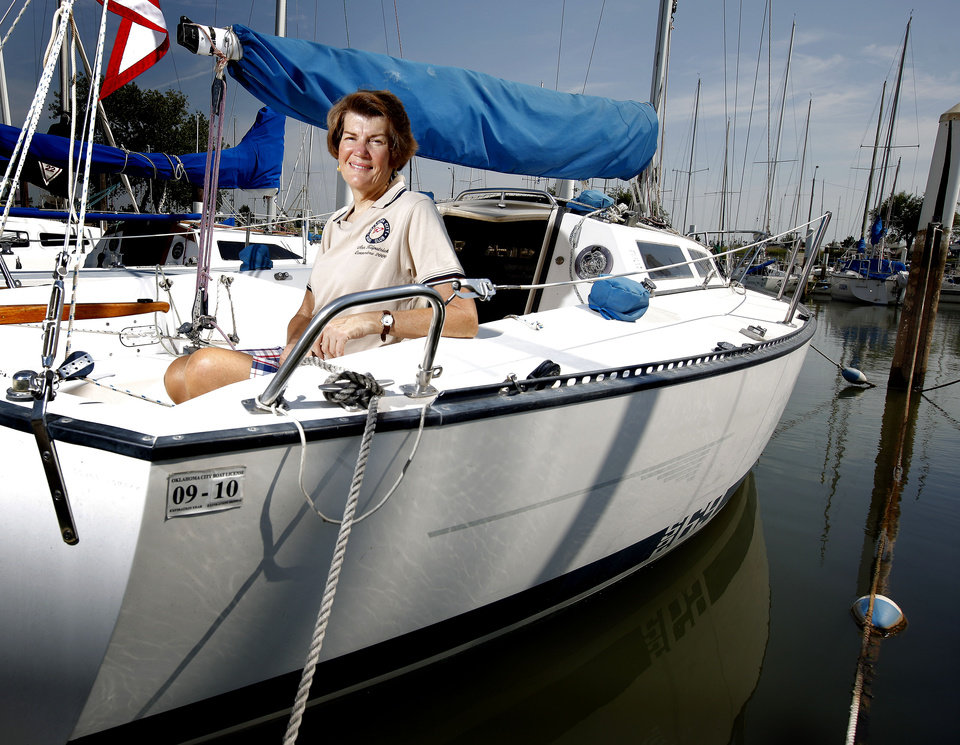 Photo - Ann Kilpatrick, commodore for the OKC Boat Club, poses for a photo on her boat at Lake Hefner in Oklahoma City, Wednesday, August 26, 2009. Photo by Bryan Terry, The Oklahoman ORG XMIT: KOD