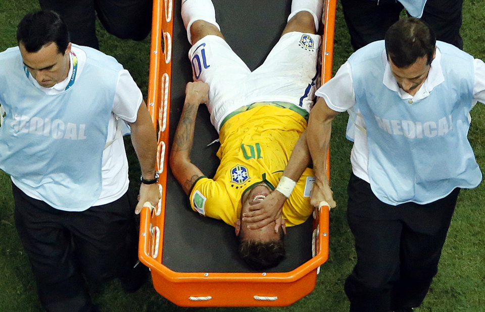 Brazil\'s Neymar is carried away on a stretcher during the World Cup quarterfinal soccer match between Brazil and Colombia at the Arena Castelao in Fortaleza, Brazil, Friday, July 4, 2014. (AP Photo/Fabrizio Bensch, pool)