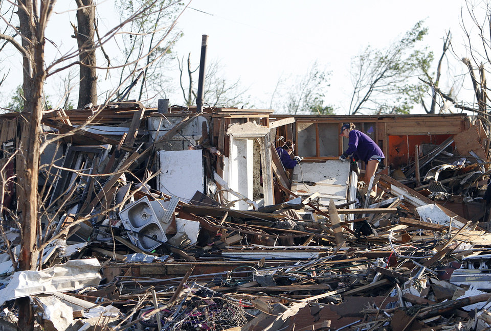 Photo - Residents search through what is left of their homes after Wednesday's tornado hit Pleasant Grove just west of downtown Birmingham, Ala., on Thursday, April 28, 2011. (AP Photo/Butch Dill)