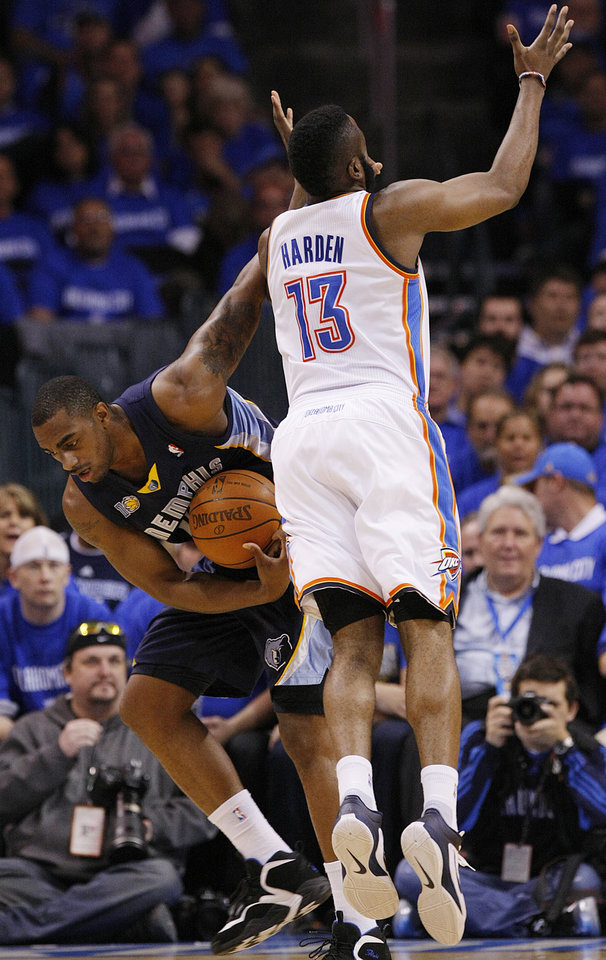 Photo - Memphis' Darrell Arthur (00) steals the ball from Oklahoma City's James Harden 913) during game one of the Western Conference semifinals between the Memphis Grizzlies and the Oklahoma City Thunder in the NBA basketball playoffs at Oklahoma City Arena in Oklahoma City, Sunday, May 1, 2011. Photo by Chris Landsberger, The Oklahoman