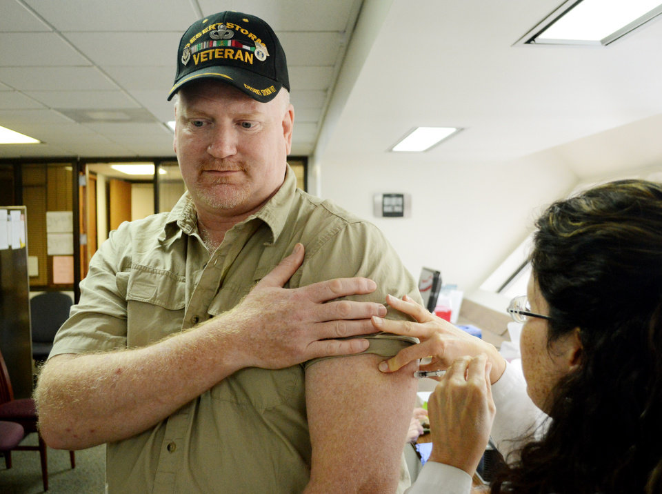 Photo -  Veteran Brad Harber, of Newalla, waits Thursday, June 12, 2014for his allergy shot at the Oklahoma Allergy and Asthma Clinic from registered nurse Dawn Hardy. Harber goes weekly for shots. Harber has struggled to get the Oklahoma City VA Medical Center to provide consistent allergy care. Photo by Jaclyn Cosgrove, The Oklahoman   Jaclyn Cosgrove