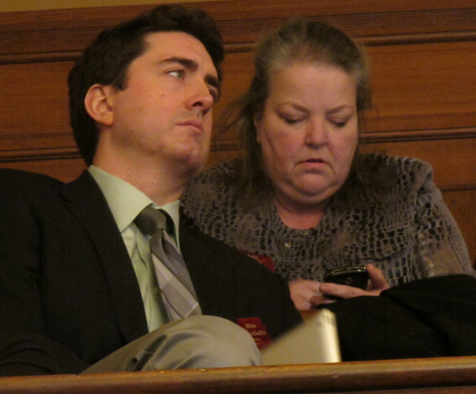 Photo - Michael Schuttloffel, left, a lobbyist for the Kansas Catholic Conference, and Kathy Ostrowski, lobbyist for the anti-abortion group Kansans for Life, follow the Kansas Senate's debate on a bill banning sex-selection abortions from the gallery, Tuesday, Feb. 19, 2013, at the Statehouse in Topeka, Kan. (AP Photo/John Hanna)