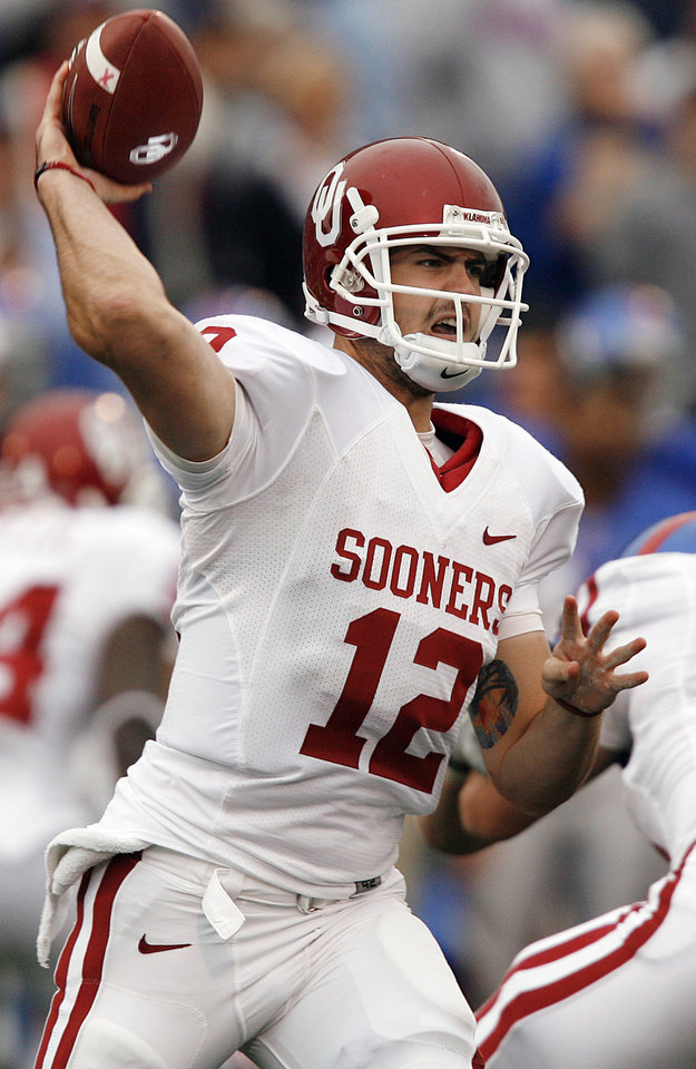 Photo - Oklahoma Landry Jones (12) throws a pass against Kansas during the second half of the college football game between the University of Oklahoma Sooners (OU) and the University of Kansas Jayhawks (KU) on Saturday, Oct. 24, 2009, in Lawrence, Kan. Oklahoma won the game 35-13. Photo by Chris Landsberger, The Oklahoman