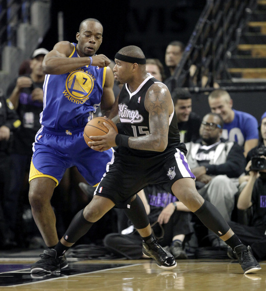 Sacramento Kings center DeMarcus Cousins, right, goes to the basket against Golden State Warriors forward Carl Landry during the first half of an NBA basketball game in Sacramento, Calif., Monday, Nov. 5, 2012. (AP Photo/Rich Pedroncelli)