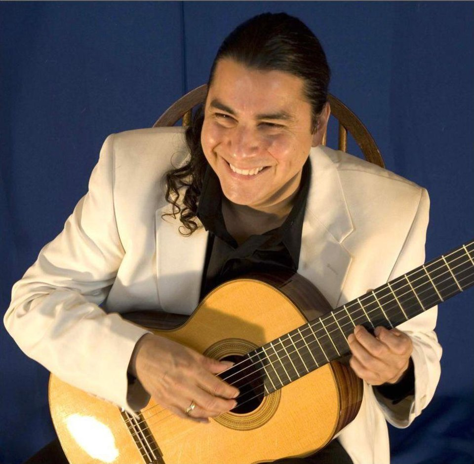 Photo - Guitarist Edgar Cruz, above right, will perform at 9 tonight at The Blue Door, 2805 N McKinley. Information: 524-0738.   ORG XMIT: 0908061548368991